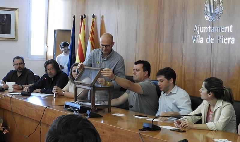 Jordi Madrid i Josep Llopart, al centre, el 2018