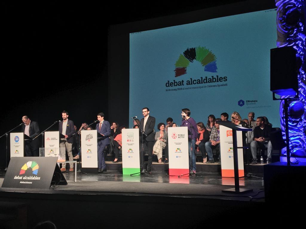 Els sis candidats, a l'inici del debat